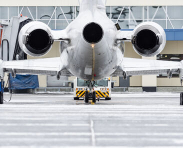 View of the engines and tail of the aircraft when push back at the airport
